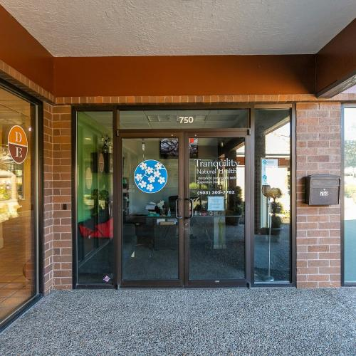 Front doors to available space for lease